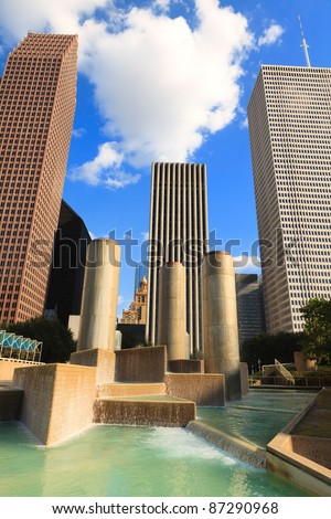 Downtown Houston, Texas cityscape with fountain and tall skyscrapers.