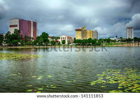 stock-photo-downtown-lakeland-florida-on-lake-mirror-141111853.jpg