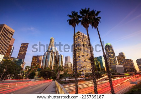 Downtown Los Angeles skyline during rush hour at sunset #225735187