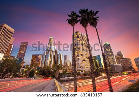 Downtown Los Angeles skyline during rush hour at sunset #635413157