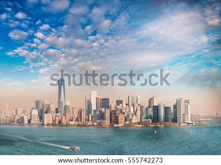 Downtown Manhattan at sunset as seen from Ellis Island, panoramic view. #555742273