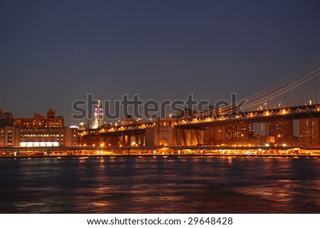 downtown manhattan, new york at night view towards empire state building seen from brooklyn