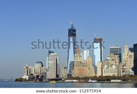 Downtown Manhattan skyline with World Trade Center Building construction peaking above the city
