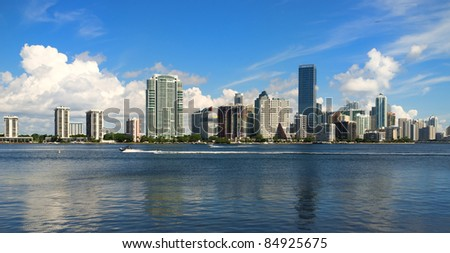 Downtown Miami skyline along Brickell Avenue with skiers enjoying Biscayne Bay.