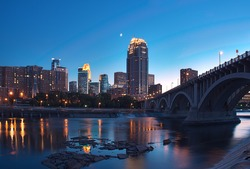 Downtown Minneapolis Minnesota & Partial Moon - St Anthony Falls and lock & dam in foreground