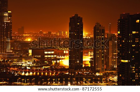 downtown night scene with city lights, luxury new high tech town