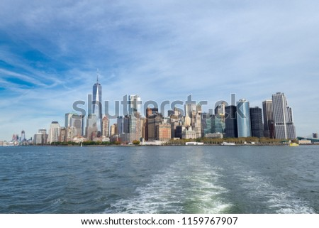 Downtown NYC from a ferry to Liberty Island #1159767907