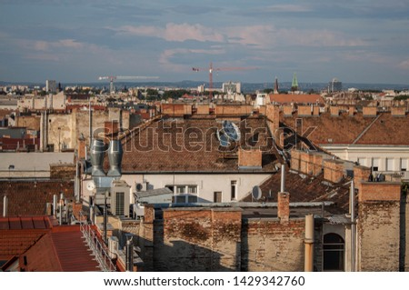 Downtown of Budapest, Hungary from above. Rooftop view with buildings, towers and colorful rooftops. European capital city skyline. #1429342760
