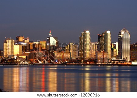 Downtown of San Diego, Ca, skyline, sailing, clear evening.