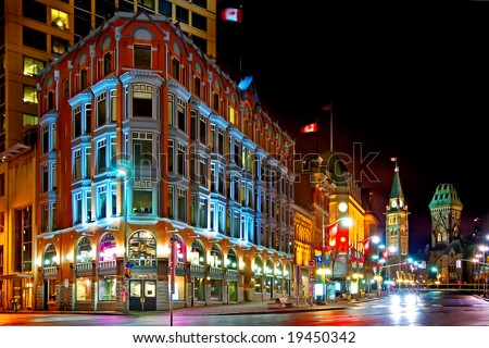 Downtown Ottawa at night.  Shows historic Chambers building and the clock tower of the parliament of Canada