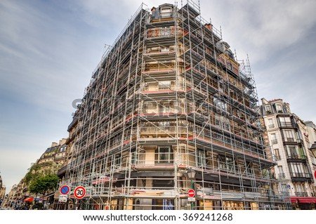 Downtown Paris, this building is encased in scaffolding so that it can be restored.