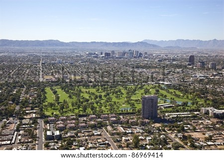 Downtown Phoenix, Arizona skyline with golf course in foreground
