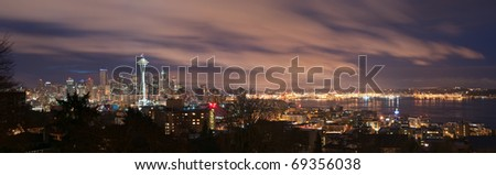 Downtown Seattle, Washington and Puget Sound panorama at night.