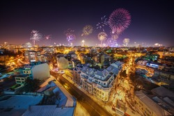 Downtown Varna cityscape with many flashing fireworks celebrating New Year's Eve