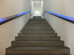 Downward view of a brown staircase