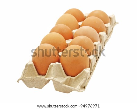 Dozen of fresh eggs in a pot isolated on white background.