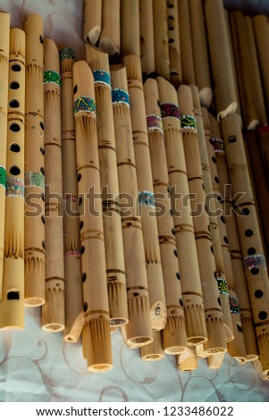 Dozens of handmade bamboo flutes in the view #1233486022