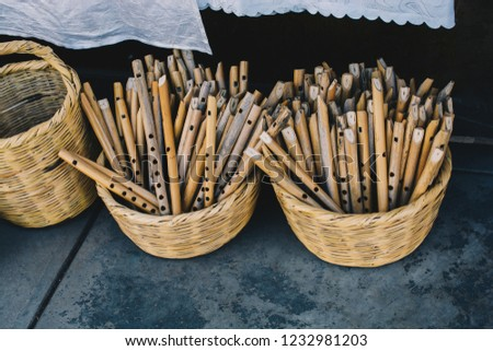 Dozens of handmade wooden flutes in the view #1232981203