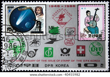 DPR KOREA - CIRCA 1986: A stamp printed by DPR KOREA (North Korea) honoring 10 th anniversary of the issue of stamps of the DPR Korea, circa 1986