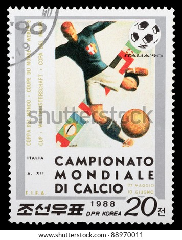 DPR KOREA - CIRCA 1988: a stamp printed by DPR KOREA shows football players. World football cup in Italy, series, circa 1988