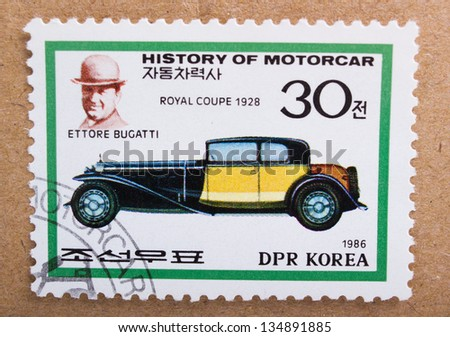 DPR KOREA - CIRCA 1968: A stamp printed in DPR Korea shows Ettore Bugatti and car Royal Coupe from 1928, circa 1968