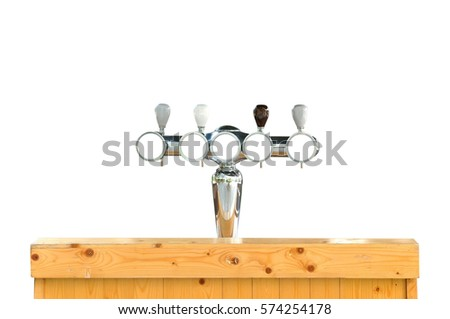 Draft beer dispenser and wooden counter on white background.