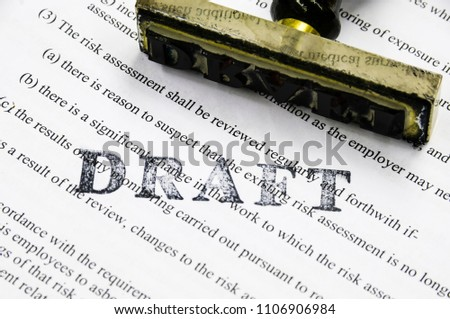 Draft stamp on a page containing risk assessment/policy procedures