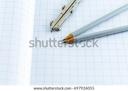 free photos compass and pencil on graph paper avopix com