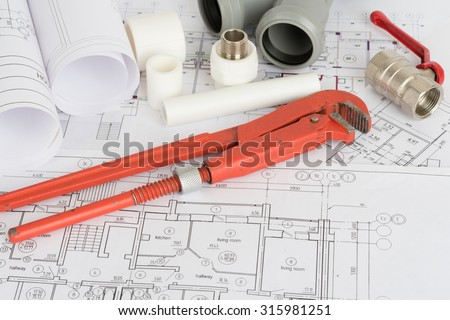 Drafts with instrument and repair parts on table #315981251