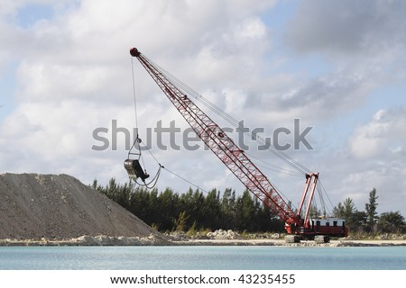 Dragline excavating coral rock for construction project