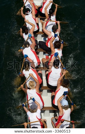 Dragon boat racers paddling - looking down on the boat from above