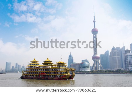 Dragon boat through the Shanghai skyline