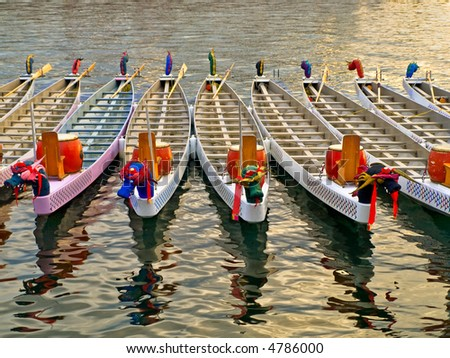 Dragon boats basking in a warm sunlight before the race