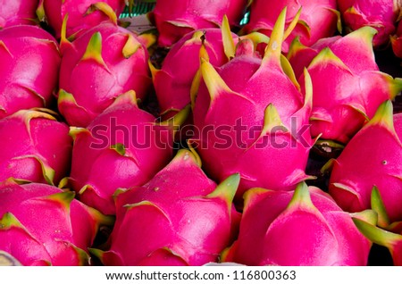 Dragon fruit on market stand, Thailand.