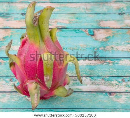 Dragon fruit over wooden background #588259103