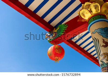 Dragon head of Chinese art in public shrine (public places) with sky background.