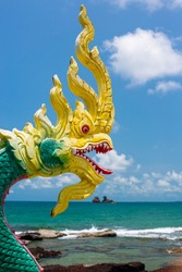 Dragon sculptures in Buddhism and sea background at Laem Mae Phim shrine Rayong, Thailand