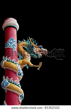 Dragon statue isolated on the black background.