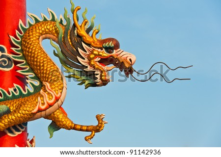 Dragon statue on pillars with blue sky