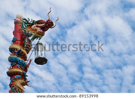 Dragon statue on the pillar and blue sky