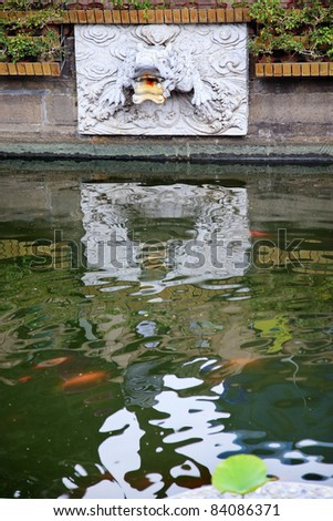 Dragon Stone Water Spout In Pond And Reflection In Yuyuan