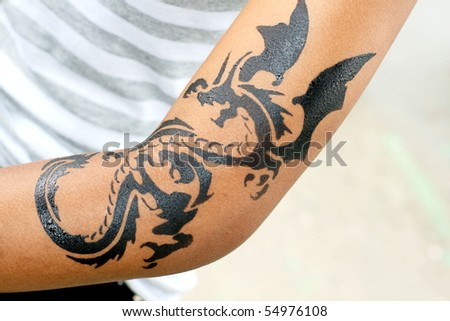 stock photo : dragon tattoo on female arm