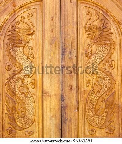 Dragon wood door texture at Chinese village - stock photo