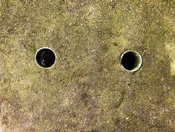 Drain holes of old cement floors, vents, construction works.