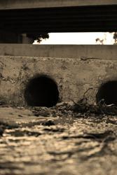 Drain pipes leading under a bridge in the River walk