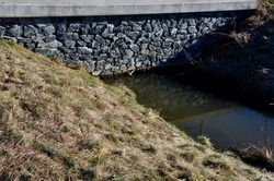 Drainage drainage reclamation channel is an outdated way to lower groundwater levels. dikes of gray stones. supplies water to irrigate fields