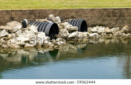 Drainage pipes going into a lake