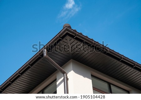 Drainage System with Plastic Siding Soffits and Eaves against blue sky Stock photo ©