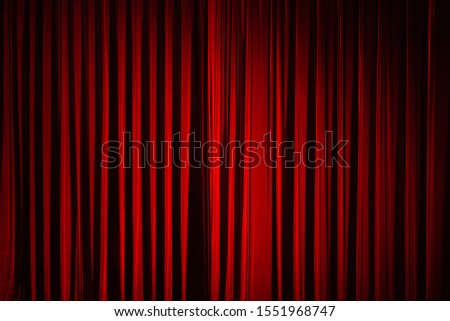 Drama theatre concept. Dark red colour stage curtain before show. Deep shadows. Text-space. Indoor shot Stock photo ©