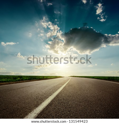dramaric sunset over asphalt road closeup